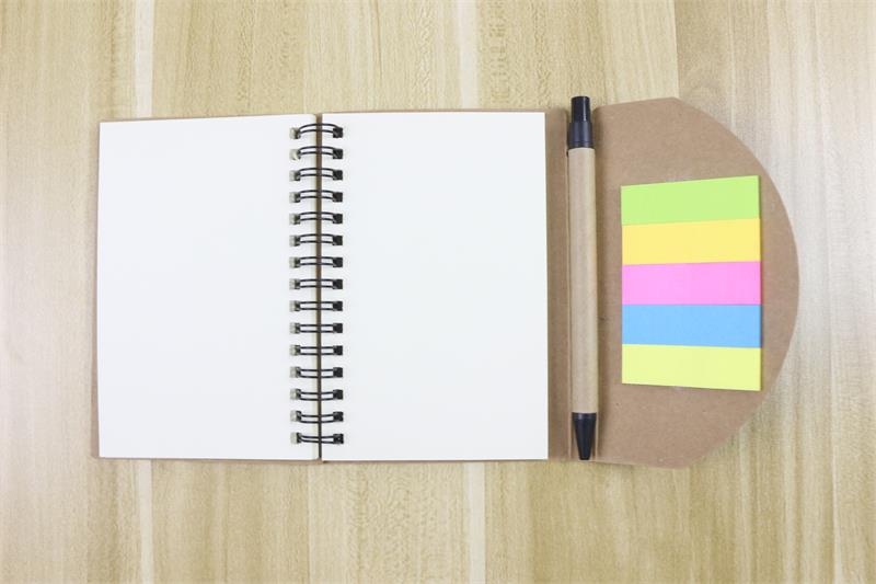 Spiral Notebook with pen sticky notes open with pen