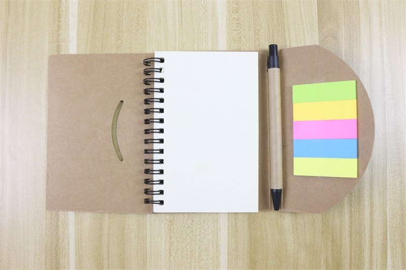 Spiral Notebook with pen sticky notes open